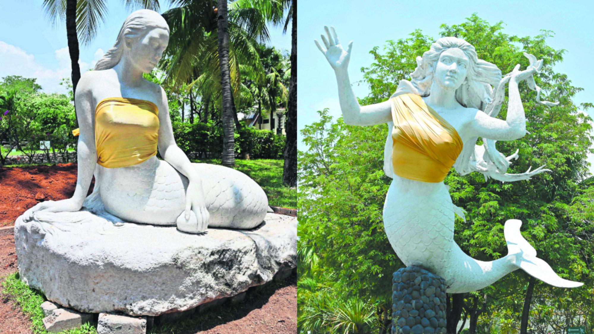 tapan los senos de dos estatuas de sirenas