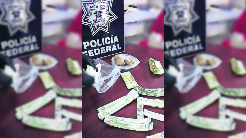detienen a colombiana aicm 52 mil dólares