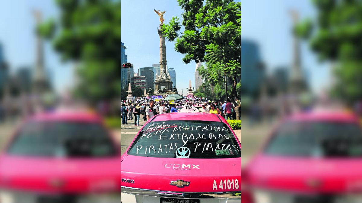 Claudia Sheinbaum trámites ilegales taxistas