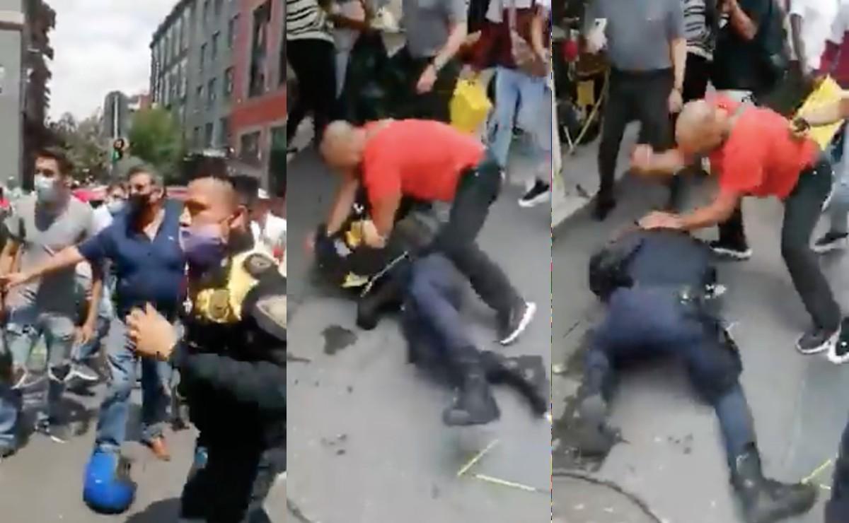 Graban golpiza a policías de tránsito en el centro de la CDMX, cuando iban a colocar araña