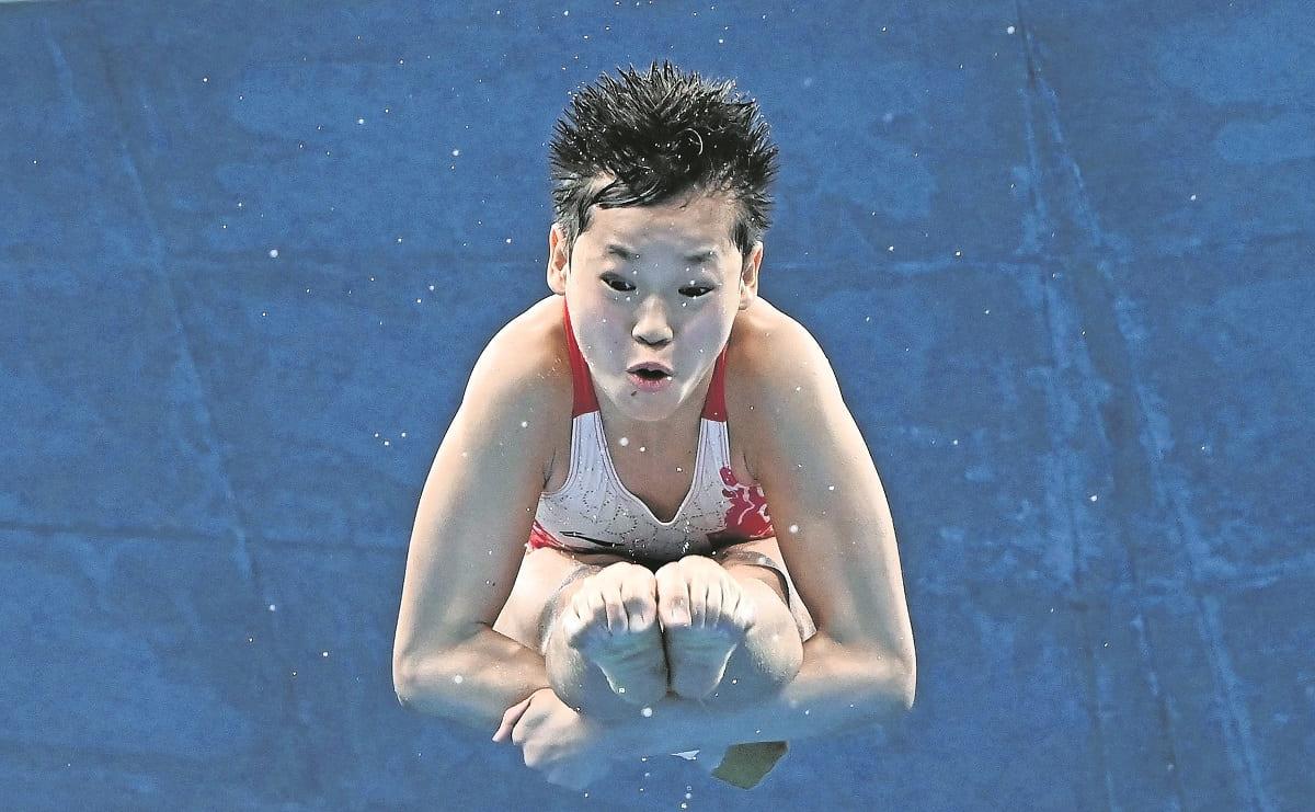 Campeona olímpica de China rechaza dinero, casa y tratamiento médico para su madre