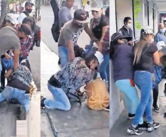 Inspectores arrastran a mujer para quitarle su mercancía en el centro del Estado de México