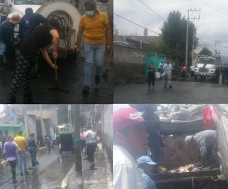 Vecinos de zonas inundadas del Edomex se unen para limpiar sus calles