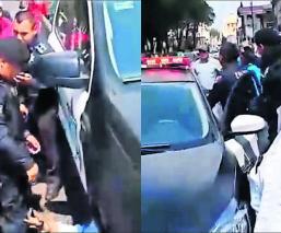Policía contra comerciantes Amenaza con arma de fuego Toluca