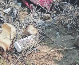 Abandonan cadáver encobijado de un hombre, en un terreno baldío de Chalco