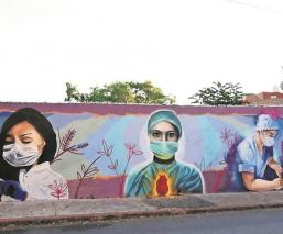 Grafitero en Morelos negaba existencia de Covid-19, ahora pinta mural en homenaje a médicos