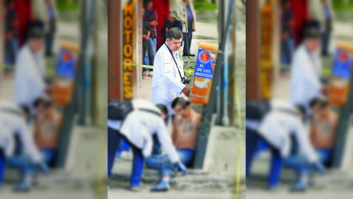 Halla a joven ahorcado con teléfono público en Tlalpan