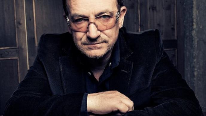 Bono, U2, paparazzi, fotógrafo, desayuno,
