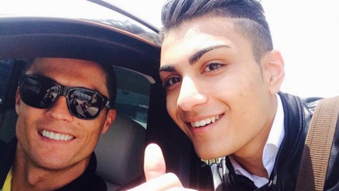 Fan de Cristiano Ronaldo parece su 'gemelo' | FOTOS