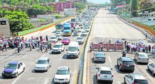 Bloquean por tercera ocasión el Paso Exprés, en Cuernavaca. Noticias en tiempo real